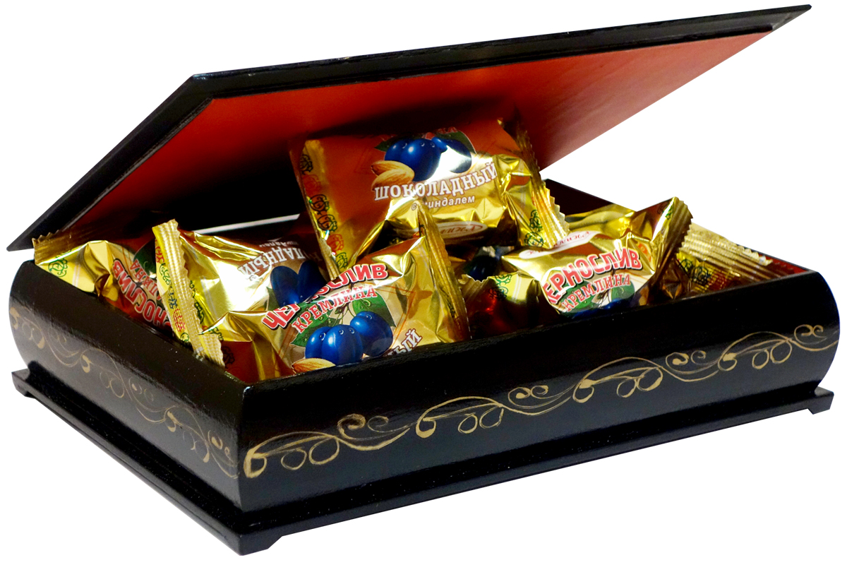 Prunes in chocolate with walnuts in a lacquer box